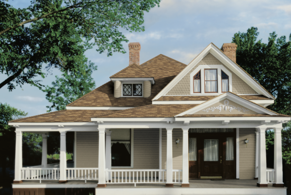A home featuring a roof with Owens Corning shingle color in brown